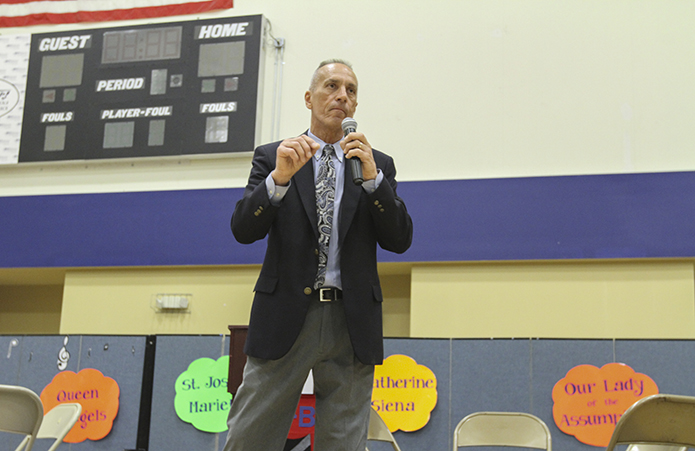 Mayor Derek Easterling of Kennesaw gives a motivational charge to the students before they set off for competition during the 16th annual Battle of the Books at St. Catherine of Siena School, Kennesaw. Photo By Michael Alexander