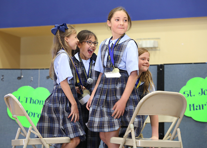 Queen of Angels students (l-r) Julianne Romine, Isabella Sutapaha, Paula Elizarreras and Caitlyn Ymbras exhibit the thrill of victory after winning the finals for third-graders. Queen of Angels School, Roswell, will host the Battle of the Books in 2019. Photo By Michael Alexander