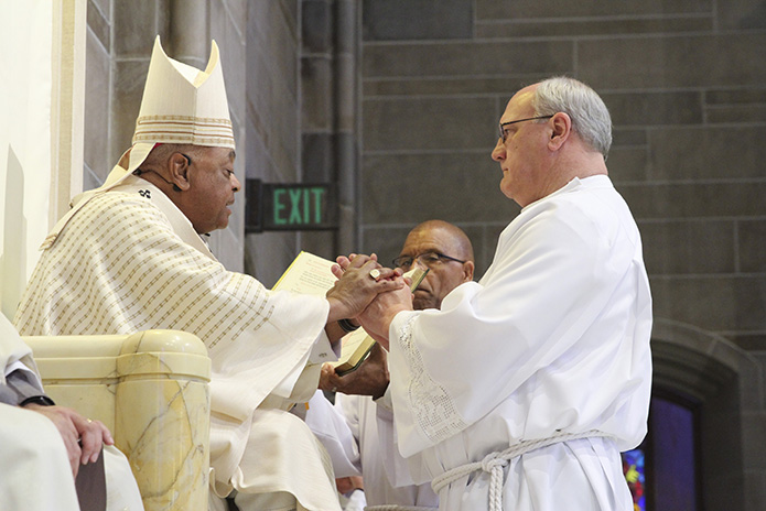 David Fragale, from Transfiguration Church, Marietta, pledges his obedience to Archbishop Wilton D. Gregory and his successors during the Feb. 3 rite of ordination to the permanent diaconate at the Cathedral of Christ the King, Atlanta. Photo By Michael Alexander