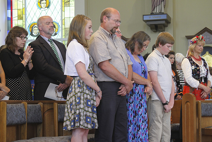 Friends and parishioners of Father Paul Flood attend the May 30 Mass marking his 25th anniversary of priestly ordination. Those on hand included (l-r) Trisha and Dennis Kelly from St. John Neumann Church, Lilburn, Kara Borgelt of St. Francis of Assisi Church, Cartersville, her father Tim, her mother Debi and her younger brother Noah. Photo By Michael Alexander