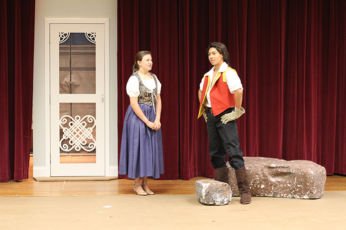 The Holy Cross Church theater ministry rehearses for its production of Disney's Beauty and the Beast Jr. during its drama camp. In this scene Gaston, played by Mario Flamenco, 15, proposes to Belle, played by Shea Jones, 14. The proceeds from the three productions, the weekend of July 18-20, benefited the parish's St. Martin de Porres food pantry. Photo By Michael Alexander