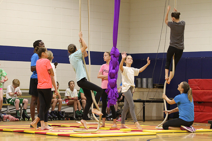 Members of the Spanish web act prepare to practice during the 8 o'clock hour on Sept. 16. Photo By Michael Alexander