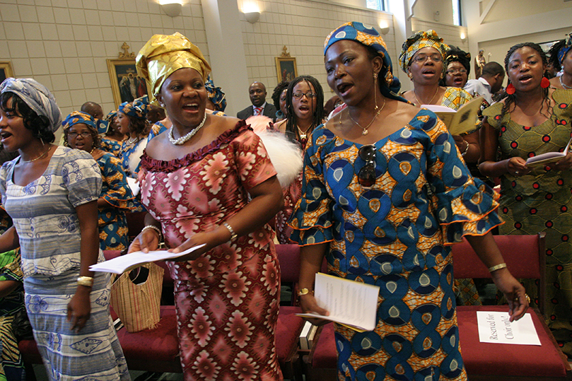 Catholic women of Cameroon decent from around the Archdiocese of Atlanta come together to make beautiful music for their monthly Mass. Photo By Michael Alexander