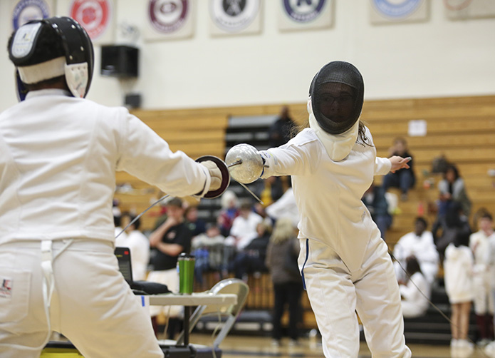 During a tournament bout at Northview High School in Johns Creek, Jan. 12, Pinecrest Academy freshman fencer Julia Hartman, right, is preparing to execute a running attack know as a fleche. Hartman won the bout against her Alpharetta High School opponent, and she also qualified for the individual fencing championship on Jan. 26 at Chattahoochee High School in Johns Creek . Photo By Michael Alexander
