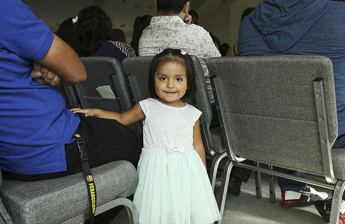 Two-year-old Jimena Nicolos represented the youth of the mission as she attended the Mass of dedication with her family. Photo By Michael Alexander