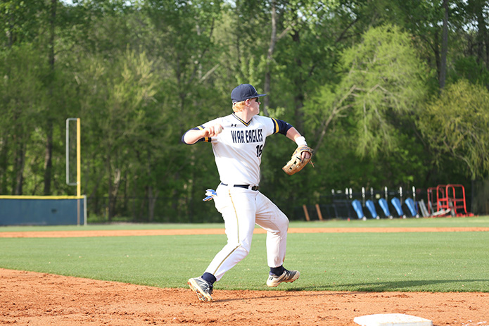After fielding a ground ball, Marist School third baseman Dean Colton throws the runner out heading to first base. Photo By Michael Alexander