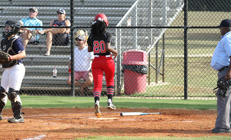 Khalani Roundtree's second inning base hit allowed Assata Eaton (#20) to cross home plate for the team's first run of the game. Photo By Michael Alexander
