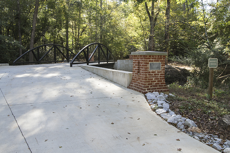 The Bridge to Grace, which takes people over Honey Creek to the burial grounds, opened in 2017. It was built in memory of Catherine Grace Schaffer, who only lived a few hours after her Oct. 9, 2015 birth. Photo By Michael Alexander