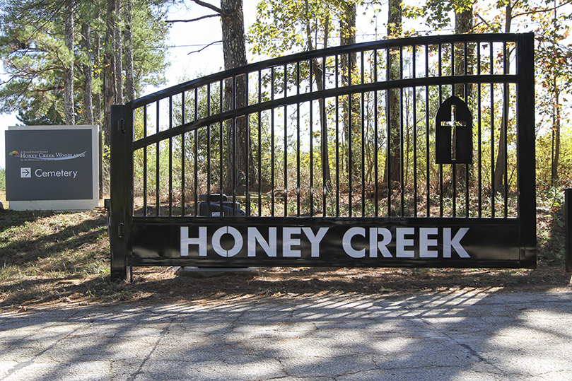 Honey Creek Woodlands didn't always have nice gate to mark its entrance. The motorized gate you drive by today was donated by Mark Hoffman, state deputy of the Georgia Knights of Columbus. It was installed by Starfire Automatic Gates and Security of Jackson. Photo By Michael Alexander