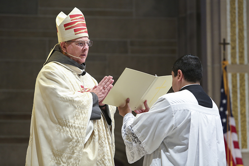 Archbishop Gregory J. Hartmayer, OFM Conv., left, accepts pastoral responsibility and care for the people of the Atlanta Archdiocese during the rite of canonical possession. It took place during his May 6 Mass of Canonical Installation at the Cathedral of Christ the King, Atlanta. Photo By Michael Alexander