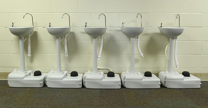 Students will find portable hand washing stations like the ones above strategically placed around St. Joseph School, Marietta, this year. Photo By Michael Alexander