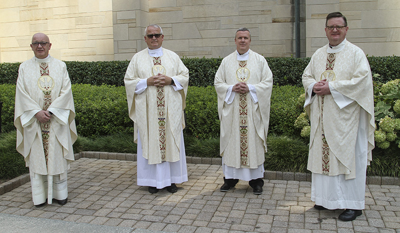Silver jubilarians (l-r) Msgr. Francis McNamee, rector of the Cathedral of Christ the King, Atlanta, Father Lawrence Niese, pastor of St. Michael the Archangel Church, Woodstock, Father Paul Williams, pastor of St. Joseph Church, Dalton, and Msgr. Joseph Corbett, pastor of St. Jude the Apostle Church, Sandy Springs, were recognized for their 25 years of priestly service to the Catholic Church. Photo By Michael Alexander