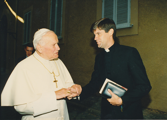 In 1993 seminarian Bernard E. (Ned) Shlesinger III, right, is greeted by Pope John Paul II at Castel Gandolfo, some 15.5 miles southeast of Rome, Italy, during his time of study at the Pontifical North American College in Rome. Photo Courtesy of Shlesinger Family