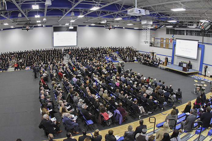 Hundreds of people fill the Robert M. Fink Family Gymnasium at Cristo Rey Atlanta Jesuit High School for the Jan. 30 school building dedication. They heard various civic, political and religious heads speak leading up to the ribbon cutting ceremony. Photo By Michael Alexander