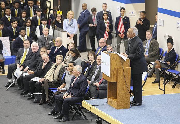 Archbishop Wilton D. Gregory addresses the crowd on hand for the Jan. 30 Cristo Rey Atlanta Jesuit High School building dedication. The school occupied the former headquarters of the Atlanta Archdiocese on West Peachtree Street for nearly three years, before moving to its new location on Piedmont Avenue. Photo By Michael Alexander
