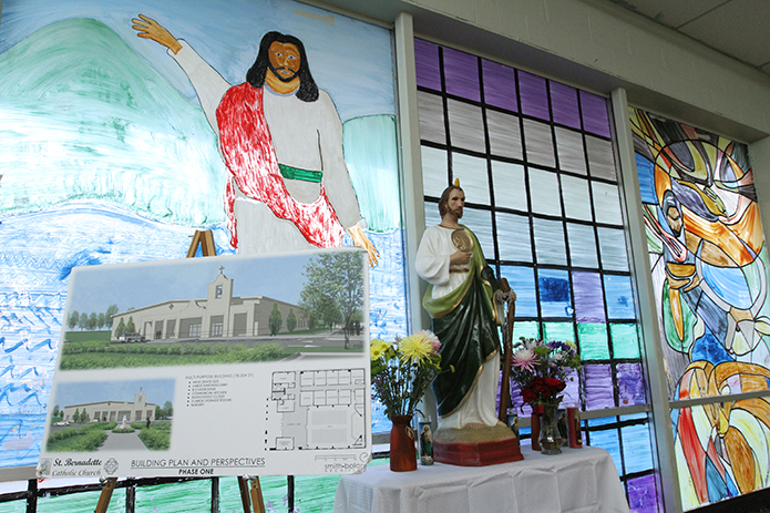 The entrance to the existing place of worship for the Hispanic community displays an architectural drawing of the proposed St. Bernadette Church in Cedartown. Photo By Michael Alexander