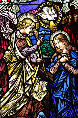 The image of the Annunciation is one of five stained glass windows in the Mary, Mother of the Eucharist Chapel at St. Monica Church in Duluth. The other windows depict the Holy Family, the flight into Egypt, the Presentation of Mary, and the Assumption. Photo By Michael Alexander