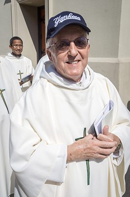 Father Rene Robert, with hat, is pictured during a 2015 procession for Mass at the Cathedral Basilica of St. Augustine in Florida. The 71-year-old priest was found dead April 18 in Burke County, Ga., after being reported missing April 12 when he did not show up for a church function. CNS photo/Woody Huband, Diocese of St. Augustine