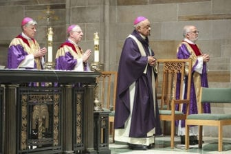 (L-r) Bishop Bernard E. Shlesinger III, Bishop Joel M. Konzen, SM, Archbishop Wilton D. Gregory and Deacon José Espinosa, associate co-director of formation for the Office of the Permanent Diaconate, stand for the reading of the Gospel during the April 10 Mass of Reparation at Cathedral of Christ the King, Atlanta. Photo By Michael Alexander